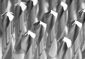 stock photo of countersink  - heap of finished metal drill tools with protective coating - JPG