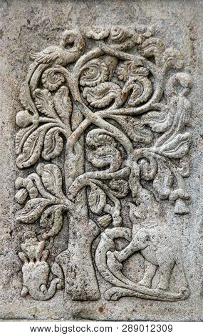 Stone basrelief with tree peacock
