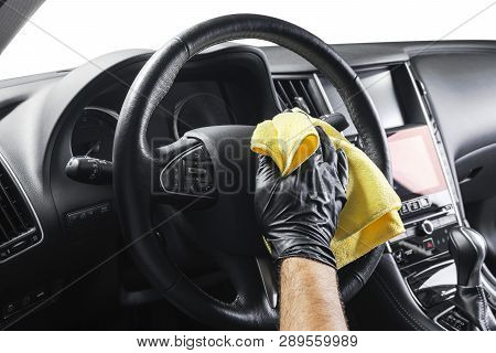poster of A Man Cleaning Car With Yellow Microfiber Cloth. Car Detailing Or Valeting Concept. Selective Focus.