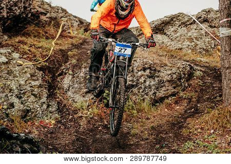 Downhill Mountain Biking Rider Down