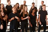 Male And Female Students Singing In Choir At Performing Arts School poster