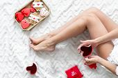 Girl In Love With Present, Heart-shaped Cookies And Mag For St Valentine Day Celebration Top View On poster