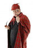 stock photo of sherlock  - Detective Sherlock Holmes investigate with magnifying glass - JPG