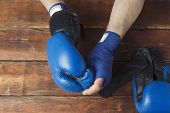 Mens Hands In Boxing Bandages And Boxing Gloves On A Wooden Background. Concept Preparation For Boxi poster