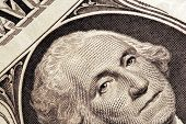 Signs And Symbols Of Business and finance. Closeup of George Washington on a US one dollar bill.
