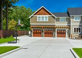 Brand New Big Farmers House With Three Garage Door And Blue Sky Background poster