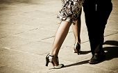 foto of legs air  - Street dancers performing tango dance - JPG