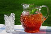 foto of iced-tea  - An antique Hobnail Pitcher full of Iced Tea with a sprig of mint - JPG