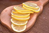 Sliced Lemon On A Wooden Board, Round Yellow Slices Close-up poster