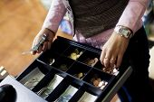 stock photo of cash register  - Woman hands on shop cash register - JPG