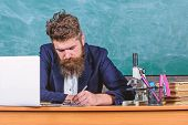 School Paperwork. Paperwork Part Of Teachers Life. Teacher Sit Desk With Laptop. Teacher Bearded Hip poster