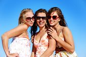 Three young woman enjoying summer