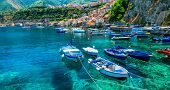 beautiful sea and places of Calabria -Scilla town with traditional fishing boats. south of Italy poster