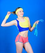 Girl In Aerobics Class. Healthy Lifestyle Concept. Woman Exercising With Jump Rope. Fitness Exercise poster