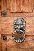 Lion Head Knocker On An Old Wooden Door. Vintage Door poster