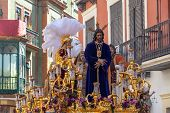 Ornate Float Featuring Jesus In A Holy Week Procession In Seville, Spain poster