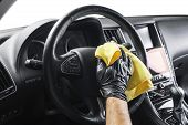 A Man Cleaning Car With Yellow Microfiber Cloth. Car Detailing Or Valeting Concept. Selective Focus. poster