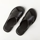 Black mens leather sandals on a white background, top view poster
