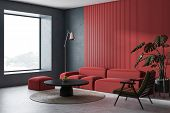 Corner Of Modern Living Room With Concrete And Red Walls, Concrete Floor, Comfortable Red Sofa And L poster