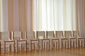 Childrens Chairs Are In A Row. A Row Of Chairs Stands Near The Window In poster