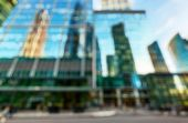 Street With Skyscrapers As Creative Abstract Blur Background. Panorama Of Modern Tall Buildings. Con poster