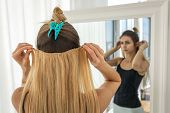 Girl Tries On Blonde False Hair Strands On Clips. Artificial Hair Extension poster