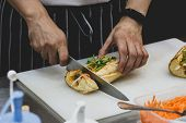 Chef Prepares Sandwich In The Kitchen, Delicious Sandwich With Veggies And Meat poster