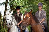 Young people horseriding