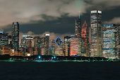 Downtown Chicago Cityscape Skyline At Night With Lake Michigan In The Foreground poster