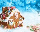 foto of gingerbread house  - Gingerbread house on a festive Christmas snow background - JPG