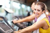 image of cardio exercise  - Happy people doing indoor biking in a fitness club - JPG