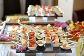 stock photo of gourmet food  - Luxury food and drinks on wedding table - JPG