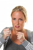 stock photo of stop fighting  - a young woman in boxhaltung is ready to fight - JPG