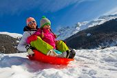 stock photo of snow-slide  - Sledding - JPG
