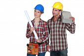 Tradesman and tradeswoman looking sideways