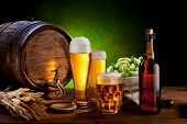 stock photo of jug  - Beer barrel with beer glasses on a wooden table - JPG