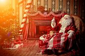 image of nicholas  - Santa Claus having a rest in a comfortable chair near the fireplace at home - JPG