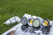 stock photo of diodes  - GU10 LED bulbs on photovoltaics in the grass E27 LED and CFL bulbs - JPG