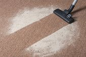 stock photo of cleanliness  - Vacuum cleaning dirt on a carpet floor - JPG