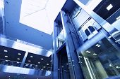 foto of lifted  - Modern interior of trade center with lift - JPG