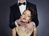 stock photo of enamored  - Fashion photo of sexy elegant couple in the tender passion - JPG