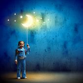 stock photo of goodnight  - Image of little cute girl with moon on rope - JPG
