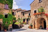 stock photo of stone house  - Picturesque corner of a quaint hill town in Italy - JPG