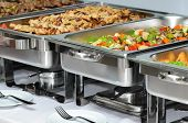 image of chafing  - served banquet table with chafing dish heaters - JPG