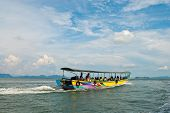 Traditional Thai Tourist Wooden Boat Putting Out To Sea poster