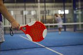 stock photo of indoor games  - Two people Playing Paddle Tennis in an - JPG