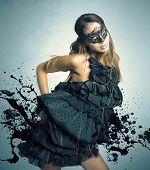 stock photo of perversion  - Sensual dark girl in a carnival mask - JPG