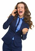 Happy Business Woman Talking Cell Phone And Rejoicing