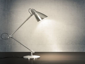 foto of lamp shade  - 3D image of metal desk lamp on wooden desk next to the concrete wall - JPG