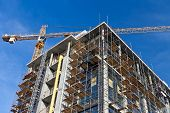 stock photo of scaffolding  - Modern building under construction - JPG